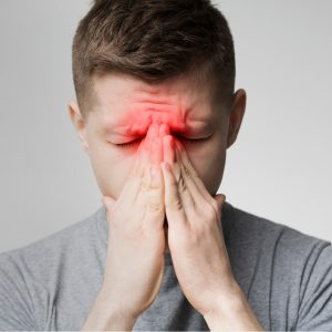 Man With Painful Sinus Headache